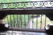 Ковка ограждение деревянного балкона