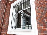 Решетка кованая- окно в частном доме