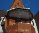 Кованый козырек над балконом