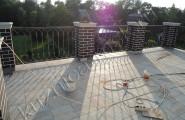 Кованое ограждение балкона в частном доме